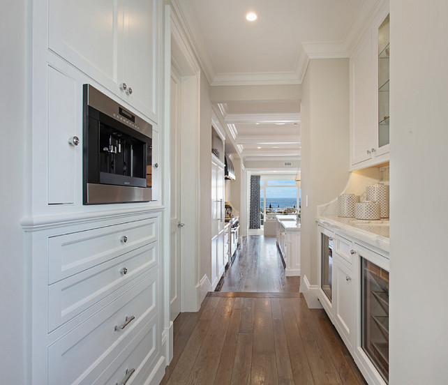 Butler's Pantry. White butler's pantry cabinet with white marble countertop and polished nickel hardware. #ButlersPantry Spinnaker Development.