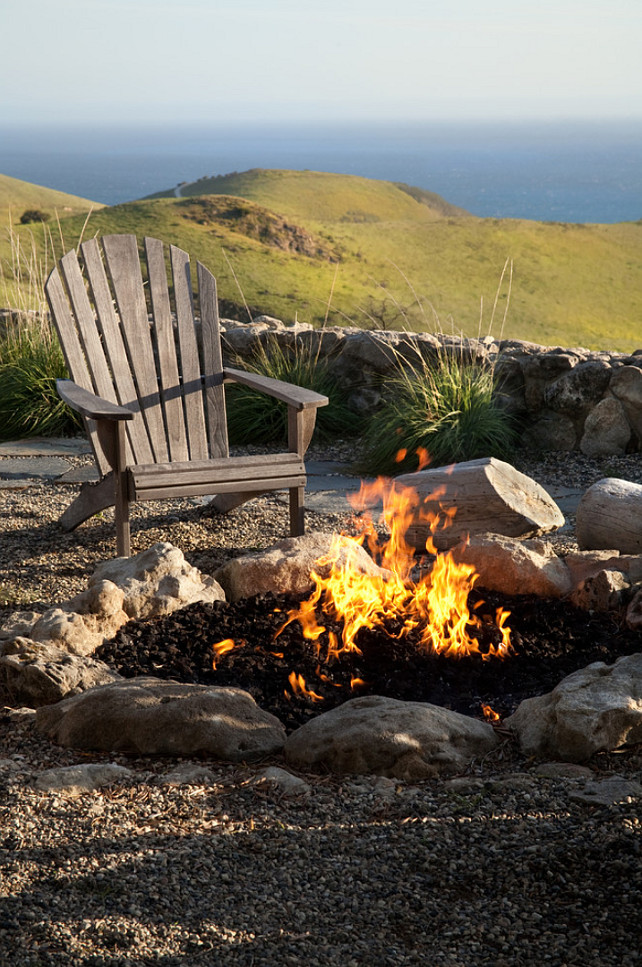 Camp Fire. Backyard camp fire. Naturalist ocean view landscape with camp fire and Adirondack chair makes for a great outdoor living space. #Backyard #CampFire Margie Grace - Grace Design Associates.