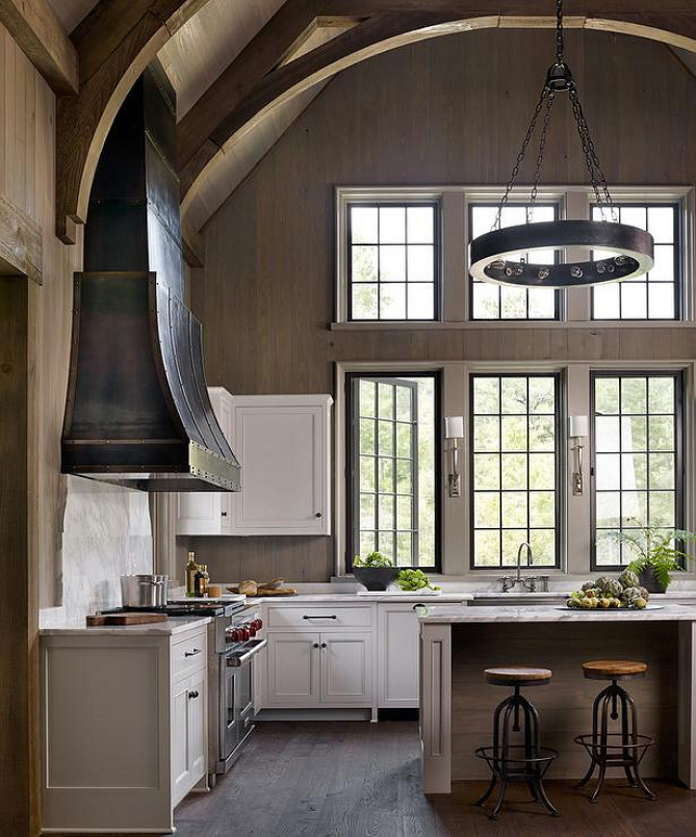 Cathedral Ceiling Kitchen Ideas. Kitchen with cathedral ceiling design. Three steel swing-out windows hang over a stainless steel apron sink and Ruhlmann Single Sconces. #Kitchen #CathedralCeiling #KitchenCathedralCeiling Dungan Nequette.