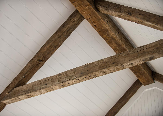 Ceiling Beams. The antique beams combine with a classic beadboard ceiling to create interest and add cottage charm to the gorgeous white great room #CeilingIdeas #AntiquedBeams #ReclaimedBeams