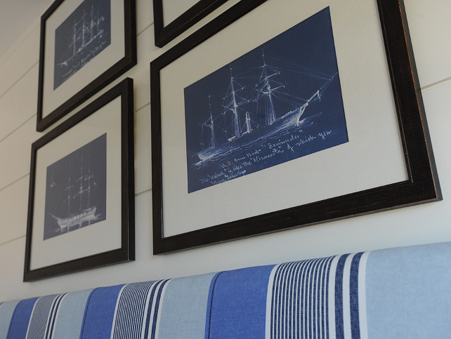 Coastal Bedroom. Coastal Bedroom Decor Ideas. Coastal Bedroom featuring framed sailboat blueprints over a blue striped headboard. #CoastalBedroom #SailboatBlueprints Nina Liddle Design.
