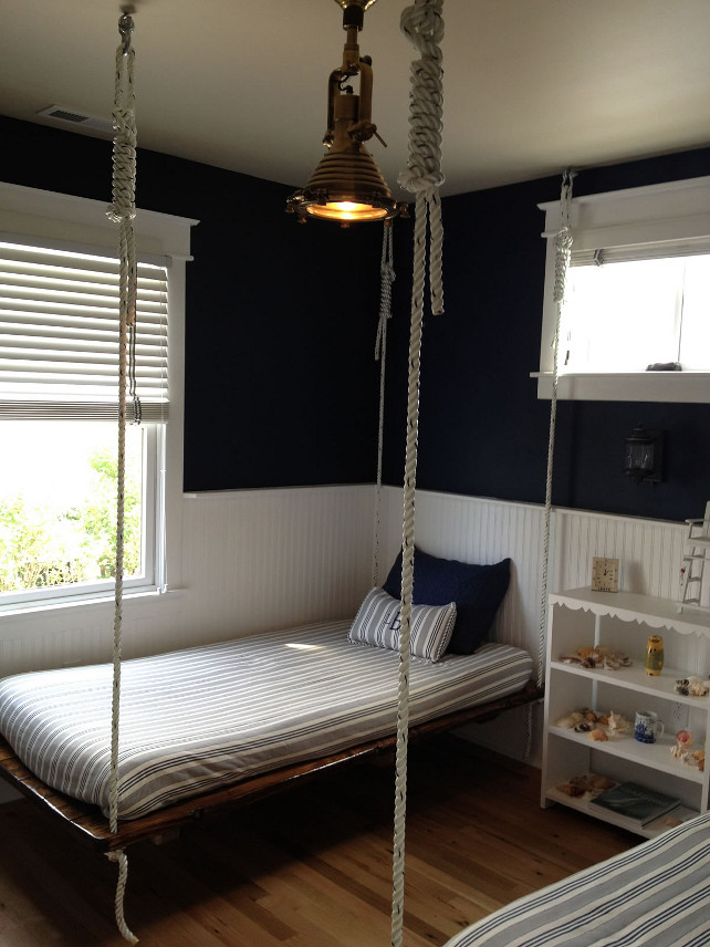 Coastal Bedroom. Coastal bedroom with split-shine plank beds hanging from dock line and a sharp navy and white color scheme. #Coastal #CoastalBedroom #PlankBed #SplitShine #Plank #Nautical #CoastalPalette
