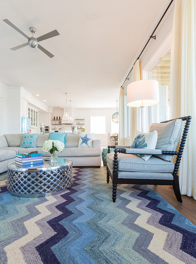 Coastal Living room with blue chevron rug, spindle chair and linen sectional. #Coastal #LivingRoom #Chevron #Rug #Sectional #Sofa #SpindleChair Laura U, Inc.