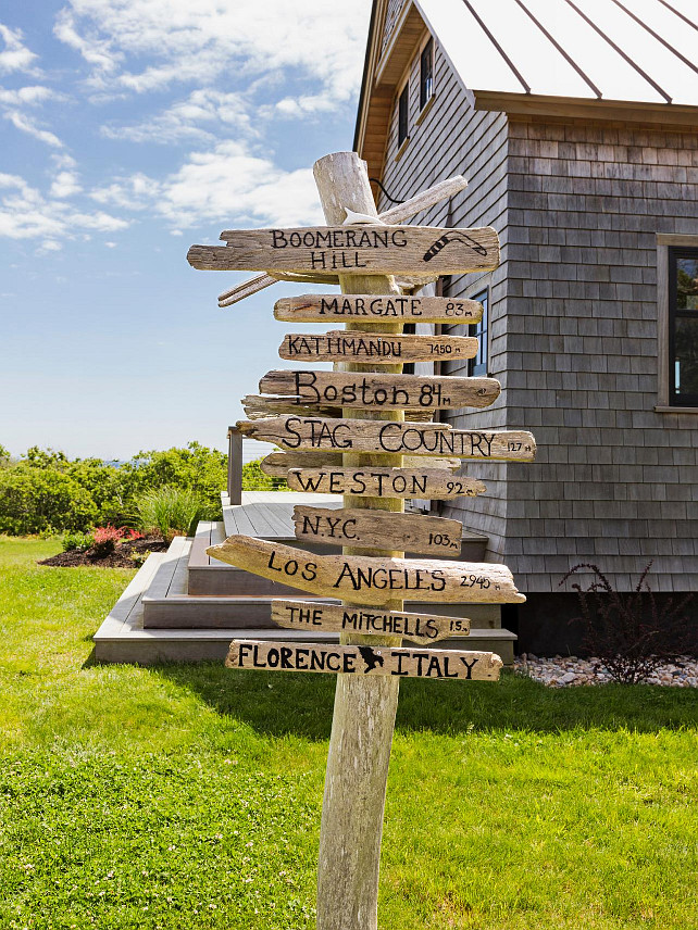 Coastal Signs. Coastal Sign Ideas. A signpost points the way to locations important to the family. #CoastalSigns HGTV.