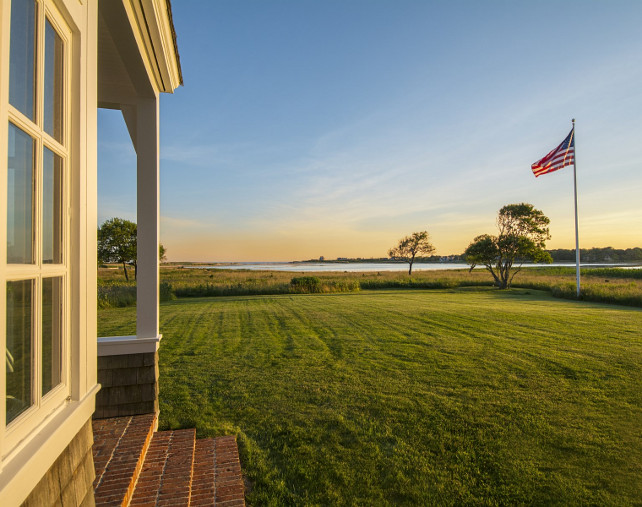 Cottage Backyard. Beach cottage with grassy backyard, ocean view and an American Flag. #Cottage #Backyard #AmericanFlag Via Sotheby's Homes.