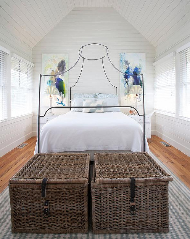 Cottage Bedroom. Cottage bedroom features shiplap walls and ceiling over an Italian Campaign Canopy Bed. #CottageBedroom #Bedroom #Cottage #Coastal Lucy and Company
