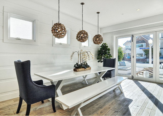 "Cottage Dining Room. Cottage Dining Room white paneled walls. Dining Room Round Driftwood Pendants. Pendants are the ""Driftwood Ball Pendant Light"" by Shades of Light. #CottageDiningRoom #DiningRoom #Cottage #CoastalCottage #DiningRoomLighting"