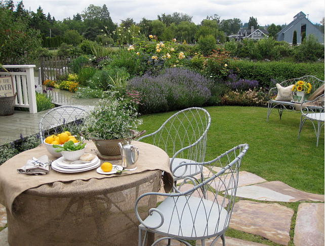 Cottage Garden. Cottage perennial, dahlia, flagstone, flagstone patio, garden ideas, iris, Phormium, planter, pots and planters, salvia. #garden #patio #plants Glenna Partridge Garden Design.