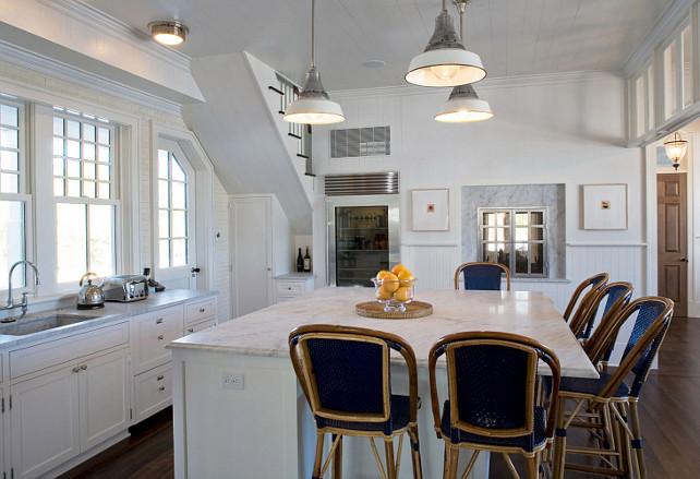 Cottage Kitchen. White Cottage Kitchen. Cottage kitchen with barn light pendants. Kitchen island with marble countertop. #Kitchen #Cottage #KitchenCottage John Hummel & Associates.