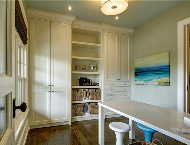 Craft Room. Craft Room Ideas. This craft room has plenty of storage with built-in cabinets. #CraftRoom #CraftRoomIdeas #CraftRoomDesignStorage
