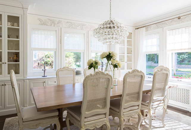 Creamy white dining room painted in Benjamin Moore White Dove OC-17. Martha O'Hara Interiors.