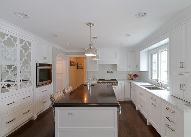Crisp White Kitchen with Dark Stained Butcher Block Countertop. #CrispWhiteKitchen #DarkStainedButcherBlockCountertop #ButcherBlockCountertop Redstart Construction.