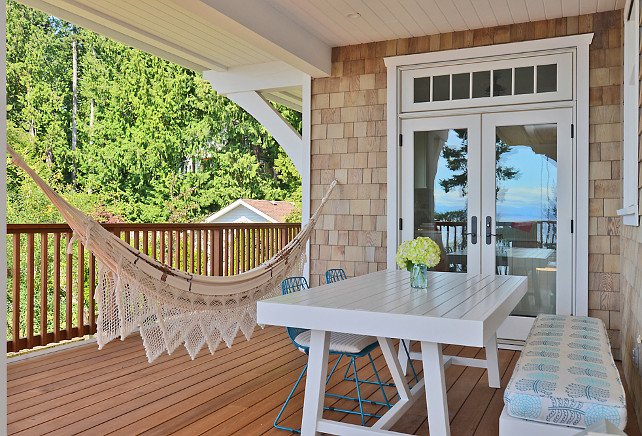 How to install a hammock in a patio: There is a post in the wall that is supporting a number of beams above. The hammock eyelet is screwed into that hidden post. Sunshine Coast Home Design.