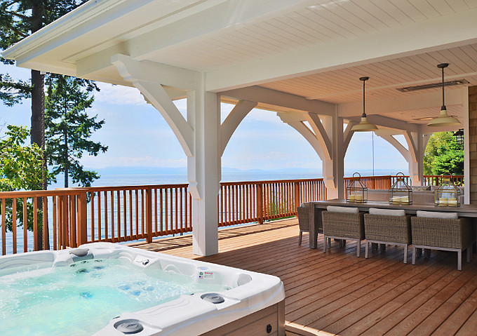 Deck with ocean view and hot tub. Sunshine Coast Home Design.