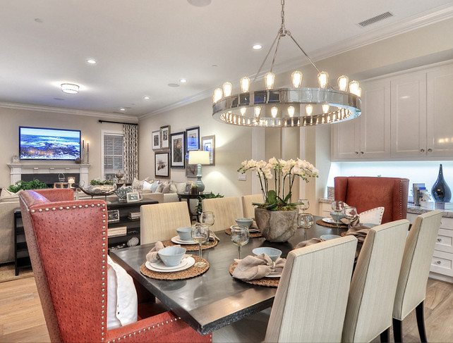Dining Area. Transitional Dining Area. Dining Area Ideas.  Above the table is a polished nickel circular chandelier, adding light and beauty to this dining area.  #DiningArea #DiningRoom