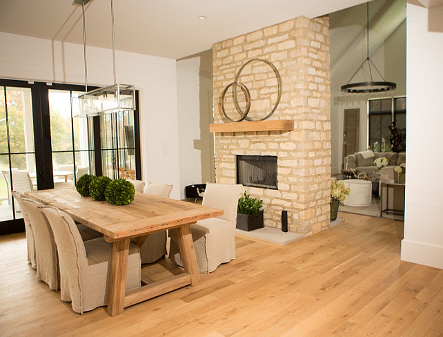 Dining Room Fireplace. Stone Dining Room Fireplace. Bleached hardwood flooring and stone fireplace in transitional dining room. #DiningRoom #Fireplace Hahn Builders.