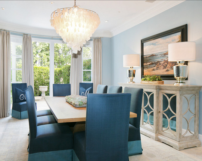 Dining Room Ideas. Dining Room Decor. The dining room has a coastal, casual feel that I love. Notice the beach-y capiz chandelier and two-tone upholstered dining chairs.  #DiningRoom #DiningRoomDecor #DiningRoomIdeas  Brooke Wagner Design.