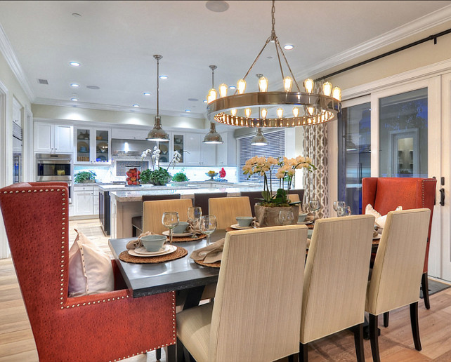 Dining Room Ideas.  Eight upholstered chairs, including two terracotta colored arm chairs, surround this large dining table. #DiningRoom  #DiningRoomFurniture #DiningRoomIdeas #DiningRoomDecor