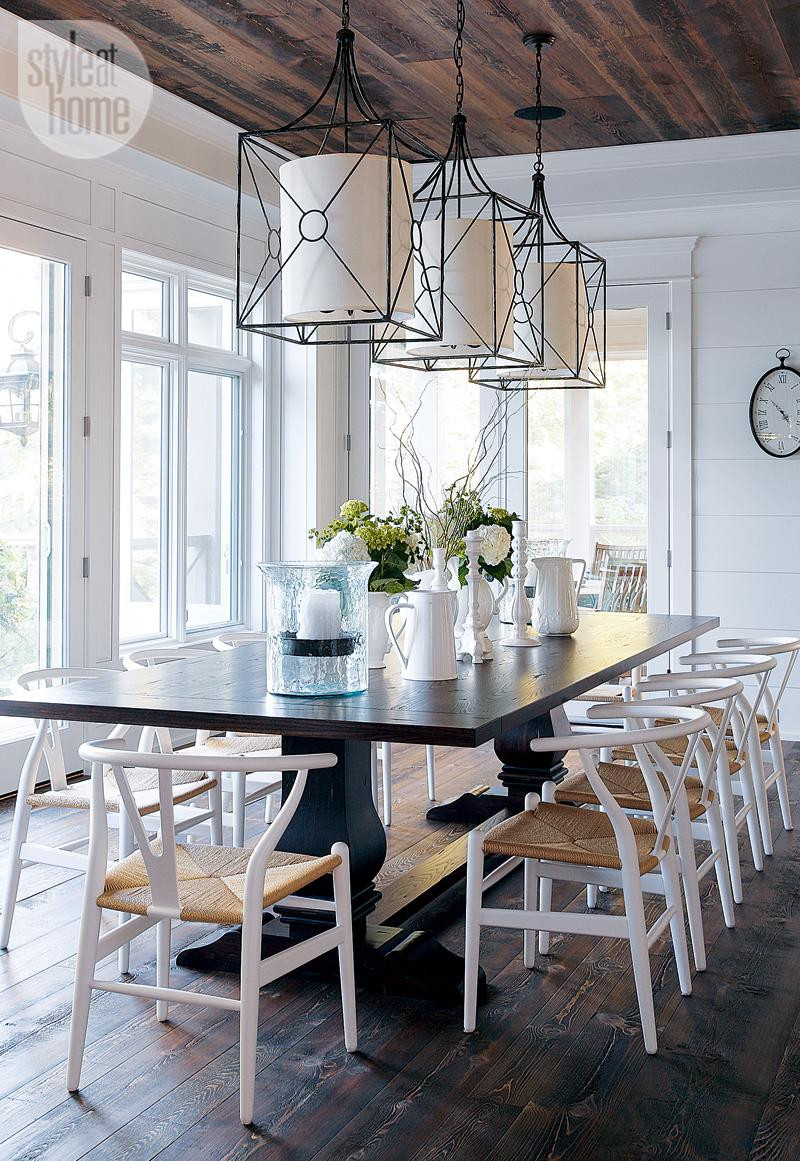 Dining Room. Cottage Dining Room. Rustic Cottage Dining Room with iron pendant lights, Wishbone-style chairs and traditional trestle table. #DiningRoom Style at Home.