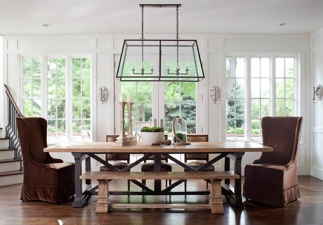 Dining Room. Dining Room with lantern pendant, guy chaddock, guy chaddock light, trestle table, sconces, ply lighting, white paneling, large windows, staircase. #DiningRoom