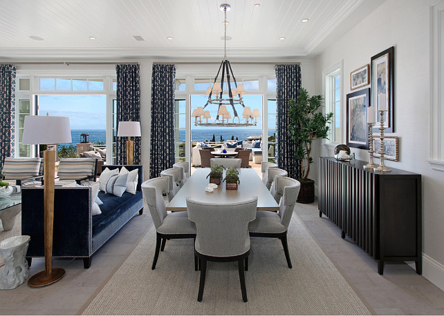 Dining Room. Ocean view dining room with a large chandelier. Dining room with Westbury Double Tier Chandelier. #WestburyDoubleTierChandelier #DiningRoom Spinnaker Development.