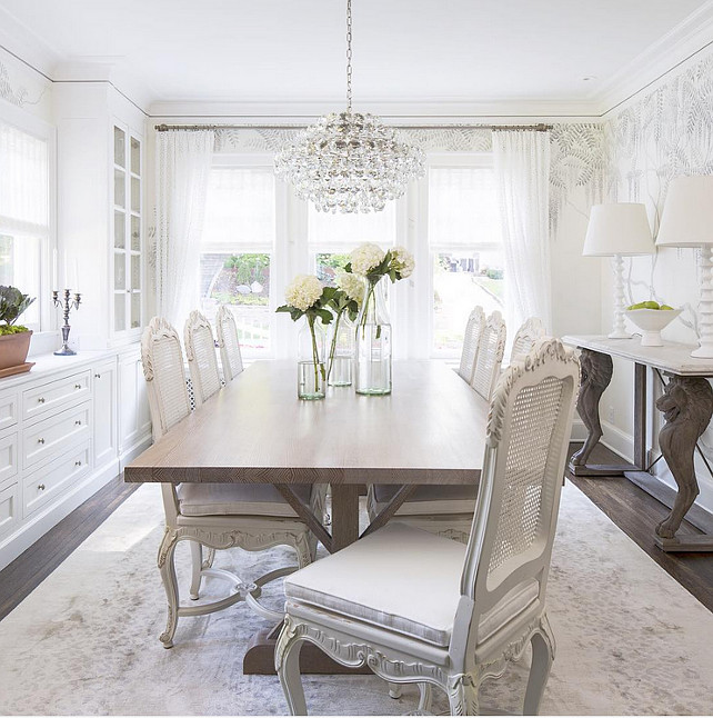 Dining Room. White Dining Room. White dining room with cane chairs and white built-in cabinets. #DiningRoom Martha O'Hara Interiors.