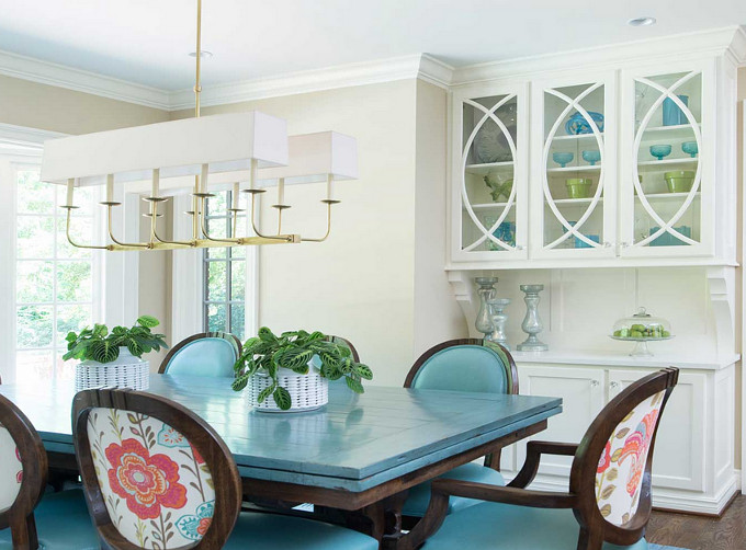 Dining room with turquoise accents. Profile Cabinet.
