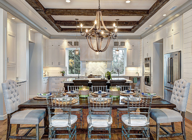 Dining room. Dining Room Beamed ceiling, Dining Room gray tufted chair, Griffin Rope Chandelier, Rectangular dining table, Rope chandelier, Rustic wood ceiling beams. Ink Architecture.