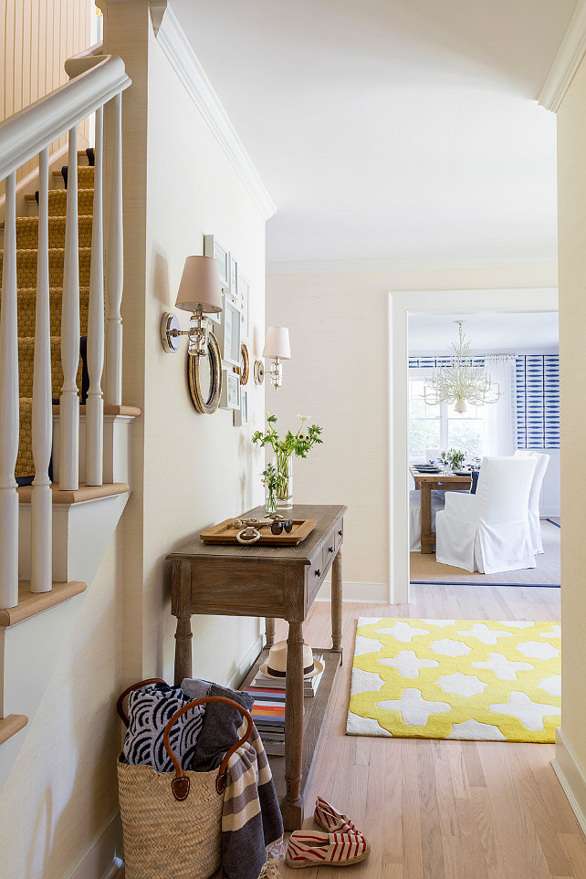 Entry foyer. Entry foyer design. Neutral entry foyer. Entry foyer view. Dining room in the distance. Foyer grasscloth covered walls, bleached oak floors. #Foyer #Entry #EntryFoyer Chango & Co.