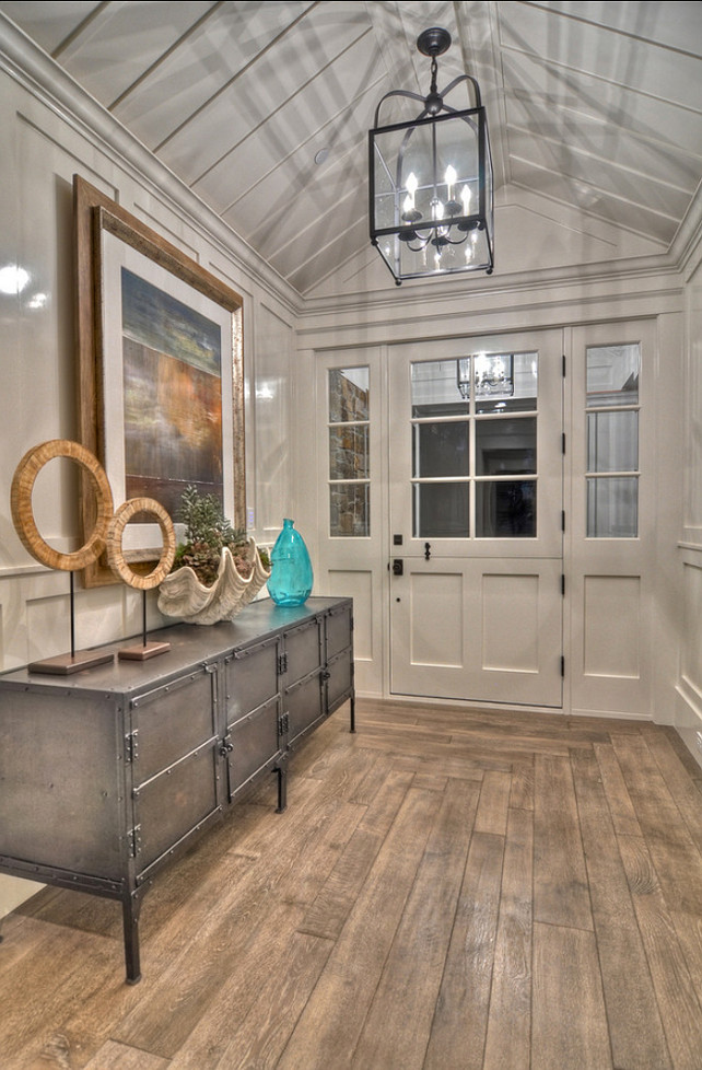 Entry. Foyer. This monochromatic entry invites guests into this casual coastal home that combines a casual feel with just a touch of formality. #Entry #Foyer