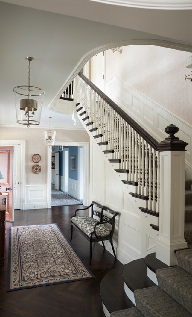 Entryway Design - Traditional Entryway Design. Traditional entryway  with herringbone hardwood flooring and classic banister design.  The lanterns is by Vaughan. #Entryway #EntrywayLighting #EntrywayBanister #HerringboneFlooring