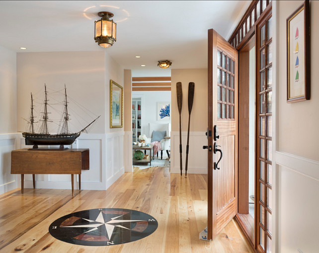 Entryway. Coastal Entryway Ideas. This is a very original coastal entryway with an antique ship model and .savage ship lights. Sailboat print is actually original art. #Entryway #EnrywayIdeas #CoastalInteriors #Coastal