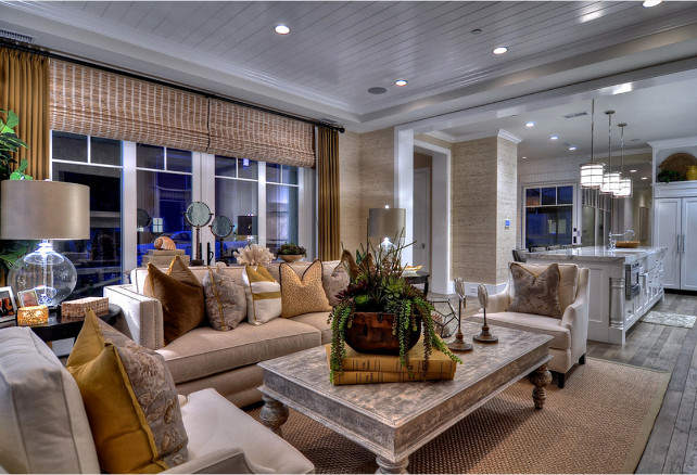Family Room Design Ideas. Wire brushed wood floors are accented by a sea grass area rug in this family room. #FamilyRoom #FamilyRoomDesign #FamilyRoomDecor