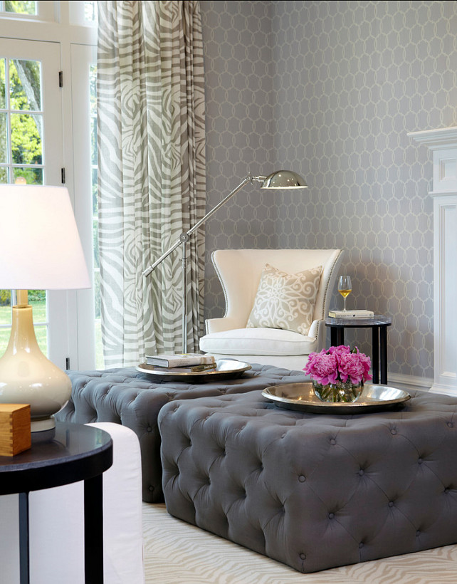 "Family Room Design. Coffee tables were replaced with two oversized tufted ottomans in dark gray which sit on a custom made beige and cream zebra pattern rug Wallpaper is the ""Schumacher Tracery Wisteria Wallpaper"".. #FamilyRoom"