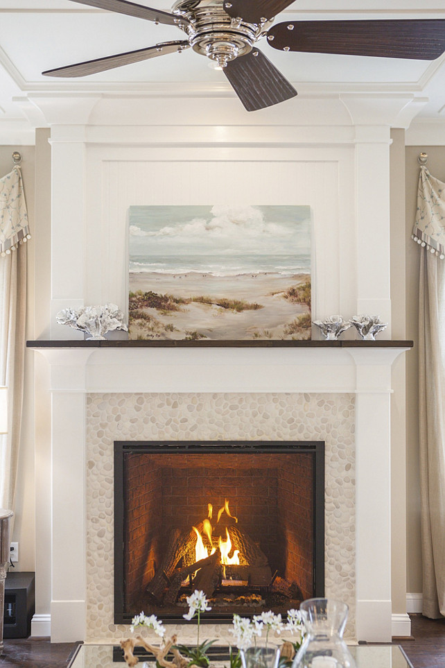 Fireplace. Coastal Fireplace Ideas. Nautical Fireplace. Beach House Fireplace. Coastal Fireplace Decorating Ideas. How to decorate a coastal inspired fireplace. Fireplace mantel and trim paint color is Sherwin Williams SW7005 Pure White. Wall paint color is SW7547 Sandbar. #Fireplace #LivingRoom #Coastal #nautical