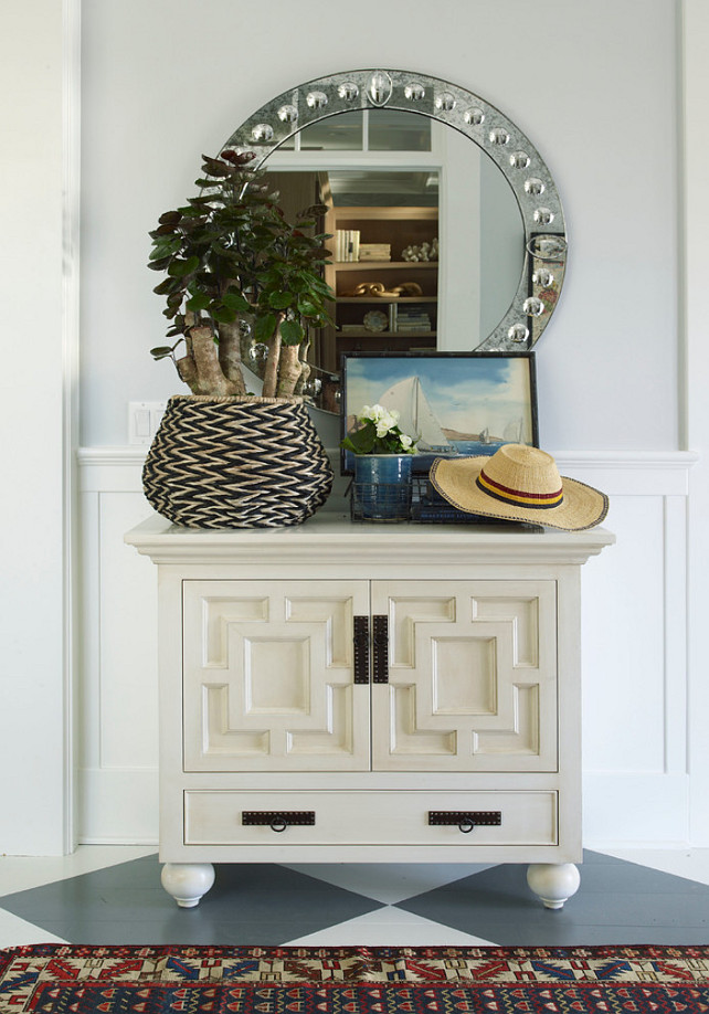 "Foyer Decor Ideas. Foyer design. Foyer furniture. Foyer with dresser and round mirror. The walls are painted ""Dovefeather by Pratt & Lambert"". #Foyer Burnham Design"