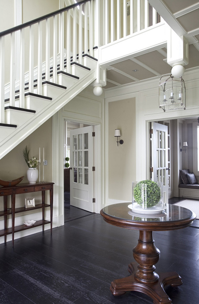 Foyer Flooring. Plank Hardwood Foyer Flooring. The floor in this foyer is a black-stained, wide-plank, oak, engineered board by Trunk Flooring. #Foyer #Flooring #WidePlank Wall Morris Design.