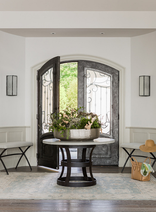 Foyer. Foyer Decorating Ideas. Beautiful Foyer with gray paint color and custom steel front door. #Foyer #FoyerDesign #FoyerDecor Anita Clark Design.