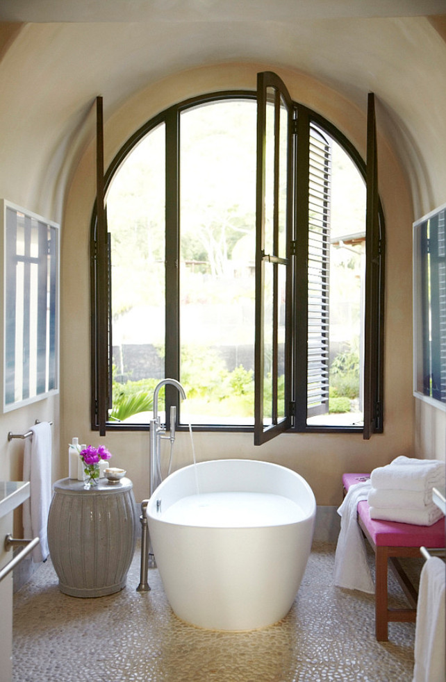 Freestading bath under window. Interior Design by Beth Webb Interiors.