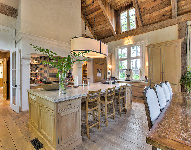 French Country Kitchen Island. The kitchen is all about charm and family time. I love the large island and the whitewashed oak cabinets. French Country Kitchen Island Ideas. French Country Kitchen Island. French Country Kitchen Island with Limestone Countertop. #FrenchCountry #KitchenIsland