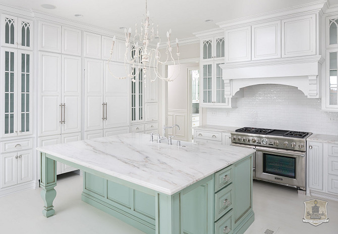 French Kitchen with white perimeter cabinets and mint green kitchen island. #FrenchKitchen #French #KItchen #French #WhiteKitchen #MintGreen #Island Stonecroft Homes.