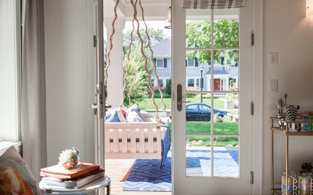 Front Porch with French doors and swing. Photos by Caitlin Abrams.