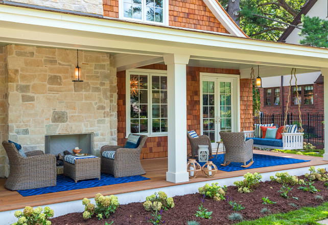 Front Porch. New front porch idea. Front porch with outdoor fireplace, outdoor furniture and swing. #FrontPorch #Porch #OutdoorFireplace #Swing #OutdoorFurniture Great Neighborhood Homes.