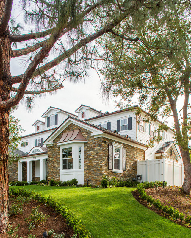 Front yard with mature trees and new landscaping. #landscaping #Gardens Legacy Custom Homes, Inc.