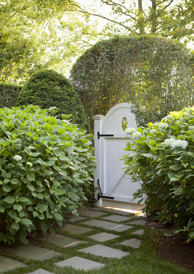 Garden Gate. White garden gate surrounded by hedges and mature landscaping. #Gate #Garden #Landscaping Emily Gilbert Photography.