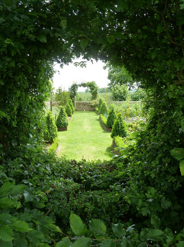 Garden. French Garden Design Ideas. #FrenchGarden  The vegetable garden can be seen from the hydrangea garden through an oeil-de-boeuf, or round window, trimmed into the hedge. Philippe DUBREUIL Jardiniste.