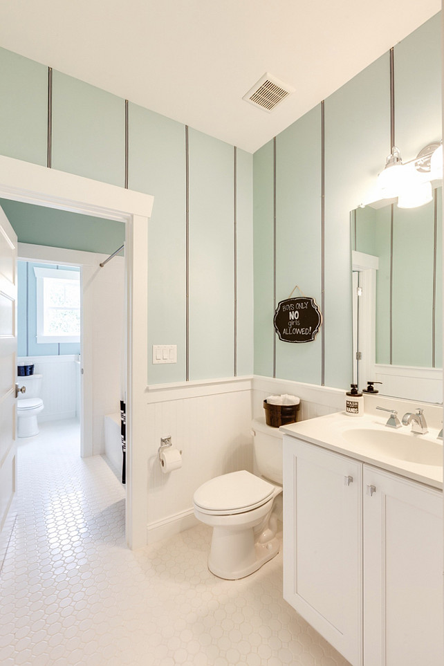 Girls Bathroom Ideas. Cute seafoam girls bathroom with striped walls and classic white octagon tiles. #GirlsBathroom #Bathroom