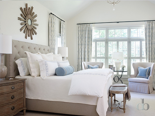 Gray Bedroom Ideas. Gray Bedroom with Blue Accents. Gray and blue bedroom features a wood sunburst mirror over a gray linen tufted bed. #GrayBedroom #BlueBedroom Jessica Bradley Interiors
