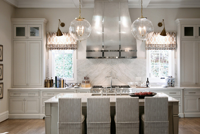 Gray Kitchen. Pale Gray Kitchen. Gray Kitchen Cabinet with custom hood. #Kitchen #GrayKitchen #GrayKitchenPaintColor #PaleGrayKitchen Barbara Brown Photography. Bell Kitchen and Bath Studios.