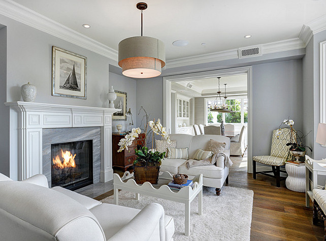 Gray Living Room. Gray Living Room with white sofas. Gray Living Room with white accents. Lighting is the Restoration Hardware Two-Tier Round Shade Pendant. #GrayLivingRoom #LivingRoo
